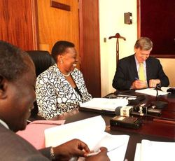 Uganda-Energy-Minister-and-AAE-Boss-signing-deal
